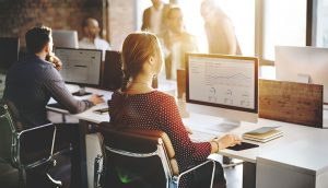 How does technology contribute to efficiency in the workplace and create a positive working environment?